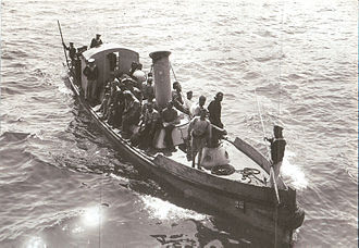 Eric Gascoigne Robinson - HMS Triumphs picket boat returning to the battleship after the E15 expedition.