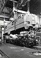 HUA-169903-Afbeelding van de electrische locomotief nr 1211 serie 1200 van de NS in de takels in de stelplaats van de centrale werkplaats van de NS te Tilburg.jpg