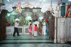 Hanuman Temple, Connaught Place - Sanctum wall with Hanuman and other deities facing south