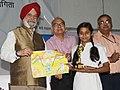 "Hardeep Singh Puri presenting the awards to the winners of the painting competition among school children on Swachhata Hi Sewa, as part of the ""Swachhata Hi Sewa"" Abhiyan, in New Delhi.JPG"