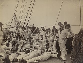 Henry C. Mustin (1874–1923) - U.S. Naval Academy midshipmen skylarking aboard USS Essex, 1893. Midshipman Henry Mustin is in the foreground on the left.