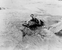 Houdini swims river in scene from The man from beyond