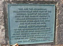 Photograph of historical plaque affixed to a rock describing Anne Hutchinnson property now in Quincy, Massachusetts