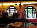 I. Das Marstall Cafe im östlichen Seitentrakt des Gebäudes mit Blick auf die Gartenbewirtung von Mensa und Cafe der Universität Heidelberg.JPG