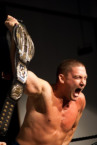 Impact Pro Wrestling - Joseph Kinkade at the Armageddon Expo 2009, holding the IPW New Zealand Heavyweight Championship belt.