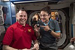 ISS-60 Nick Hague and Jessica Meir with a billiard ball in the Destiny lab.jpg