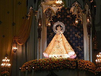 Our Lady of La Naval de Manila - The  statue enthroned above the main altar, during the month of October.