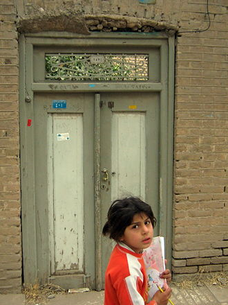Student - An Iranian student going to her classmate's house for evening studies, in Nishapur