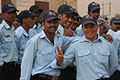 Iraqi Police cadets gather together before their graduation ceremony at the Al Furat Police Training Academy in Baghdad, Iraq, March 13, 2008 080313-A-DL064-442.jpg