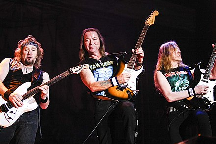 Adrian Smith (left) re-joined Iron Maiden in 1999, resulting in a three guitar line-up. Iron Maiden en Costa Rica.jpg