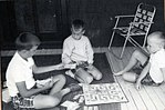 Jeb, Marvin and Neil Bush playing a board game on the porch in Kennebunkport, Maine. Summer 1964.jpg