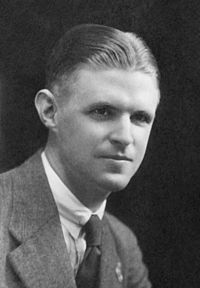 Black and white photograph of a young man wearing a business suit