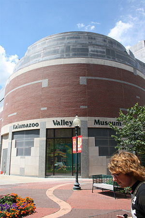 Kalamazoo Valley Museum - The back of the Museum. A pedestrian stands in the foreground.