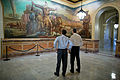 Kansas Governor Sam Brownback (left) and U.S. Secretary of Education --Arne Duncan observe a mural at the Kansas State Capitol in 2012.jpg