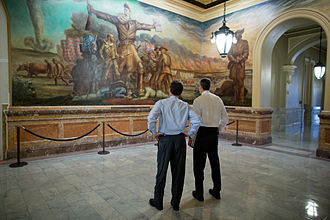 Kansas State Capitol - Kansas Governor Sam Brownback (left) and U.S. Secretary of Education Arne Duncan observe John Steuart Curry's Tragic Prelude in the second floor rotunda