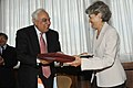 Kapil Sibal and the DG, UNESCO, Ms. Irina Bokova exchanging the signed documents of an agreement for setting up Mahatma Gandhi Institute of Education for Peace and Sustainable Development, in Paris on July 09, 2012.jpg