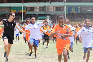 Kate Markgraf -  Kate Markgraf running with a girls group during the Soccer Clinic Program in Dire Dawa, Ethiopia from July 11–12, 2012.