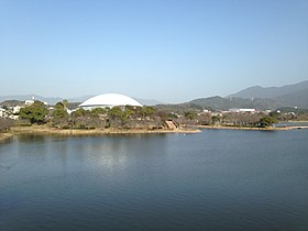 Kayoichoike Pond and Kasuya Town Gymnasium from footbridge on west side of Kayoicho Park.JPG