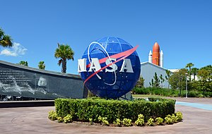 Kennedy Space Center Visitor Complex - Entrance to Kennedy Space Center, JFK memorial and Atlantis in the background