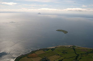 Kildonan, Arran - View over southern Arran with Kildonan and its beach clearly visible, Pladda and Ailsa Craig beyond in the Firth of Clyde
