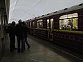 Krasnaya strela (Red arrow) train at Chistye Prudy station (Метропоезд Красная стрела на станции Чистые Пруды) (4473036542).jpg