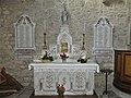 La Courtine église collatéral ouest autel.jpg