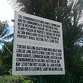 Lae War Cemetery TokPisin sign at front gate.jpg