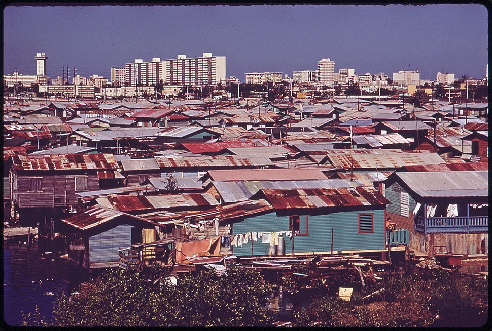 MODERN BUILDINGS TOWER OVER THE SHANTIES CROWDED ALONG THE MARTIN PENA CANAL - NARA - 546369