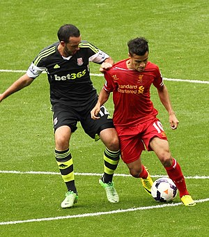 Philippe Coutinho - Coutinho being challenged by Stoke City's Marc Wilson in August 2013