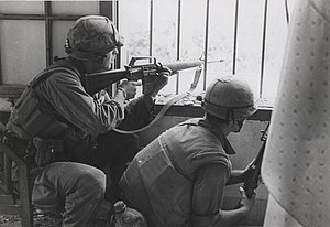 Marines Fire From a House Window, February 1968 (16242259837) (cropped).jpg