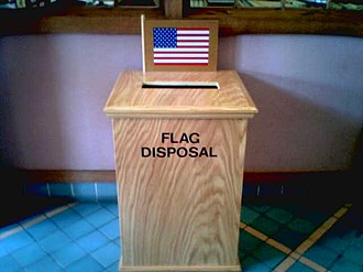 United States Flag Code - One means of collecting American flags for disposal. This box is in a public library.