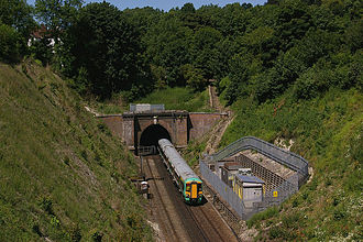 Merstham tunnels - The south portal of Merstham Tunnel in 2008 with a class 377 passing through.