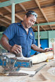Mike Rapola making prosthetic limbs at the National Orthotic & Prosthetic Services (NOPS), Port Moresby General Hospital, PNG (10702554106).jpg