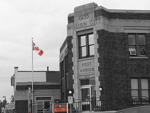 Mission Post Office By Chris McArdle from Mission BC, Canada (Canada Post  Uploaded by Skeezix1000) [CC BY-SA 2.0 (https://creativecommons.org/licenses/by-sa/2.0)], via Wikimedia Commons