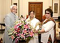 Mohd. Hamid Ansari and his wife Smt. Salma Ansari greeting the President, Smt. Pratibha Devisingh Patil on the occasion of completion of One year as the President of India, at Rashtrapati Bhavan, in New Delhi.jpg