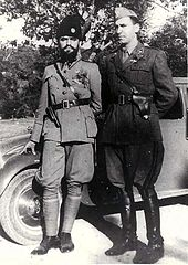 two men in uniform leaning against a car