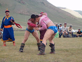 Folk wrestling - Wrestlers on the traditional Naadam festival in Mongolia, near Ulan Bator