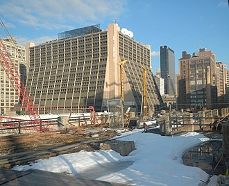 Manhattan West - View of existing 450 West 33rd Street during construction