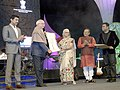 Mridula Sinha presenting the Lifetime Achievement Award to the Russian filmmaker, Mr. Nikita Mikhalkov, at the closing ceremony of the 46th International Film Festival of India (IFFI-2015), in Panaji.jpg