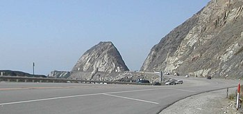 """Mugu Rock"" formed when a cut throug..."