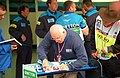 Murray Walker signs his yearbook at the 1995 British GP, Silverstone (49713882827).jpg