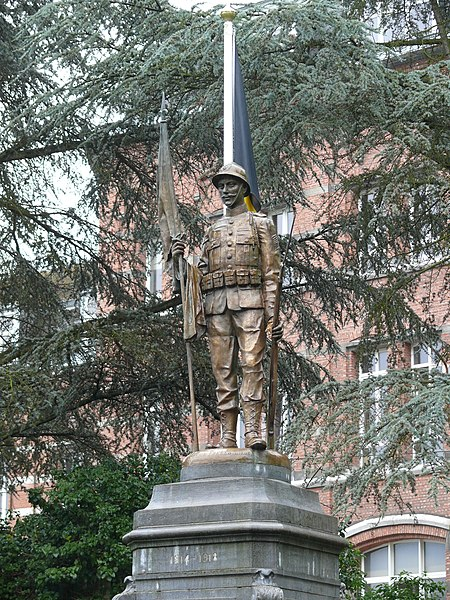 War memorial for 1st World War soldiers in the church yard of St-Berthuin Church in  Malonne (Namur). The statue was cast by the firm 'Dehin frères' from Liège