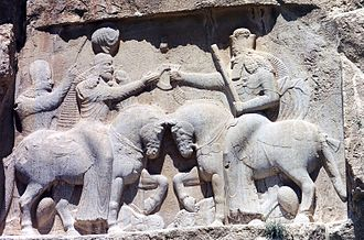 Ahura Mazda - Ahura Mazda (on the right, with high crown) presents Ardashir I (left) with the ring of kingship. (Naqsh-e Rustam, 3rd century CE)