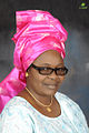 Nigerian woman in a buba blouse and the gele headtie.jpg