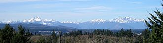 Olympic Mountains - The Olympic Mountains in winter, as seen from the east. The Brothers is the large double peak on the left, and Mount Constance is on the right.