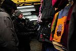 Operation Warm and Dry purchasing blankets and coats 120206-F-EY492-011.jpg