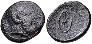 Ophellas - Cyrene coin struck under Ophellas as Ptolemaic governor, first reign, circa 322-313 BC. Æ Unit (25mm, 11.14 g, 9h). Head of Ammon right / Wheel in perspective.