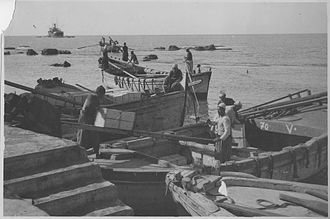 Jaffa orange - Crates of Jaffa oranges being ferried to a waiting freighter for export, circa 1930