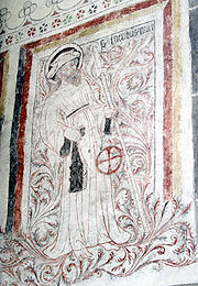 Saint James the Great with his pilgrim's staff. The hat is typical, but he often wears his emblem, the scallop shell on the front brim of the hat or elsewhere on his clothes (it may have been lost because of the deterioration of the painting)