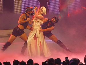 "2 Hearts (Kylie Minogue song) - Minogue performing ""2 Hearts"" during her For You, for Me Tour, 2009."